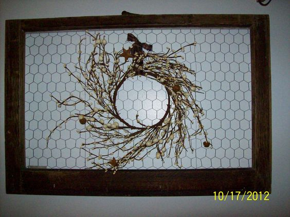 Old window frame/chicken wire, hooks and prim wreath