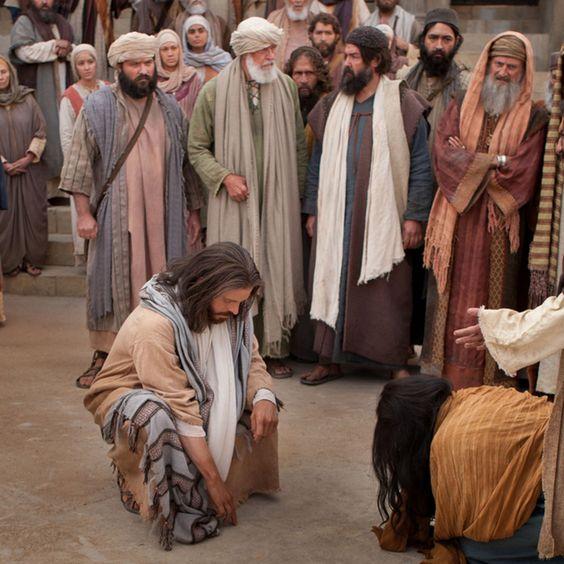 Jézus ír a  homokban