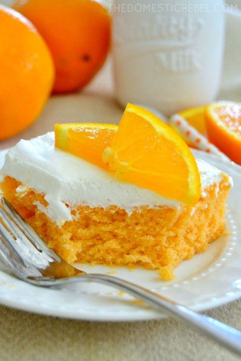 This Skinny Orange Creamsicle Cake is a cake to behold! Bursting with juicy orange and sweet cream flavor, it's a classic that's been lightened-up to a figure-friendly recipe.