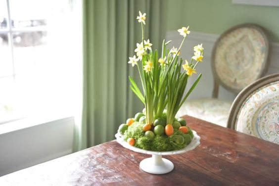 Add a touch of spring to your table with a mix daffodils, dianthus and colorful fruit.