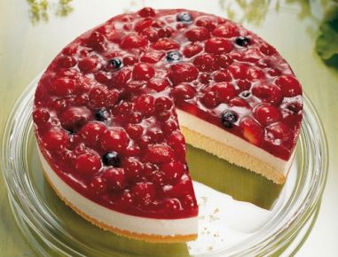 This is a German cake.  You rarely find anyone who will make a layer cake like in America.  You can use virtually any kind of fruit, but you will need a packet of Torten Gelee powder to make it gel.  There's probably a way to do it with gelatin, although that would make the results a little different.