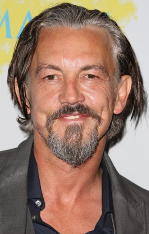 How did actortommy flanagan get his facial scars
