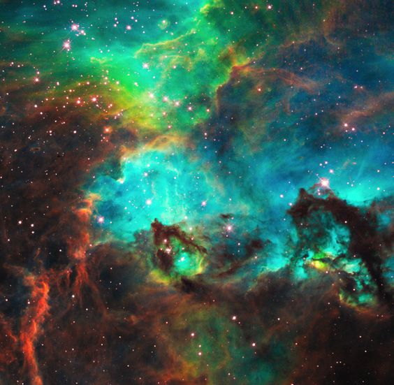 Star Cluster NGC 2074 in the Large Magellanic Cloud Hubble peered into a small portion of the nebula near the star cluster NGC 2074 (top).
