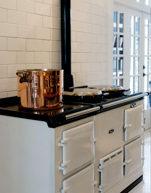 love the stove, subway tile and french doors......the copper pot is kinda cool too :)