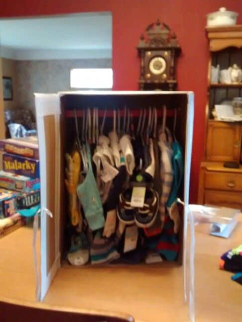Little closet doors open showing the baby's cloths for shower.
