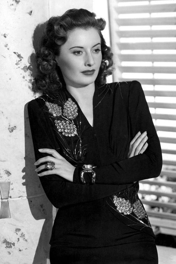 Barbara Stanwyck...1940'sFashion: The Decade Captured In 40 Incredible Pictures style rayon crepe black dress with beading flower accent photo print ad movie star 40s war era evening gown swing
