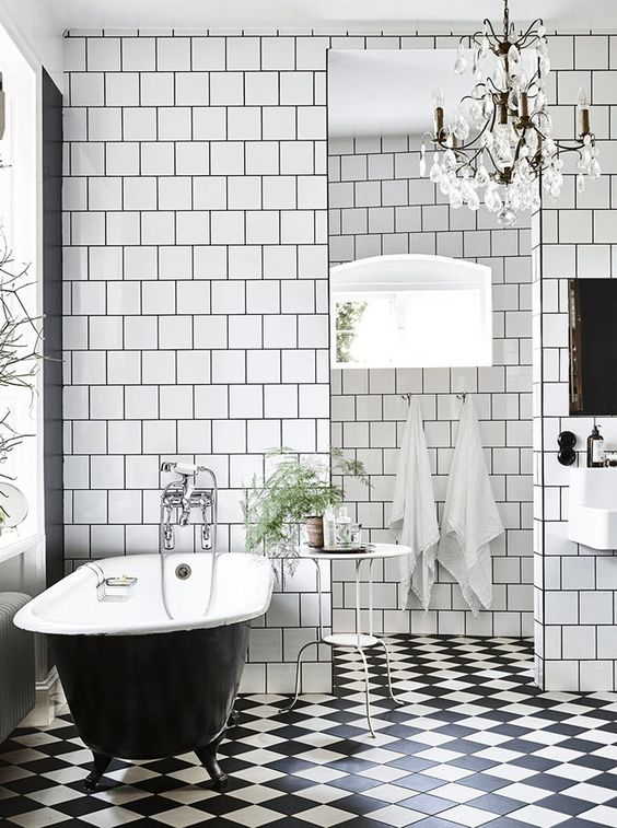 Black and white bathroom in a stunning industrial-style home in Lund, Sweden. Credits: Emma Persson Lagerberg / Andrea Papini. Elle Decoration.: