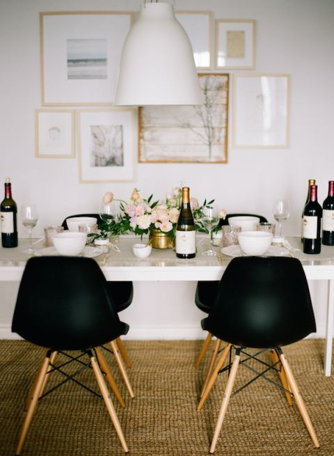 These chairs look matte... I love it! They're so bold against the white wall and dining table. The flowers add a nice, subtle touch. Wouldn't mind a few of those bottles either! Very very nice, slightly rustic rug too!