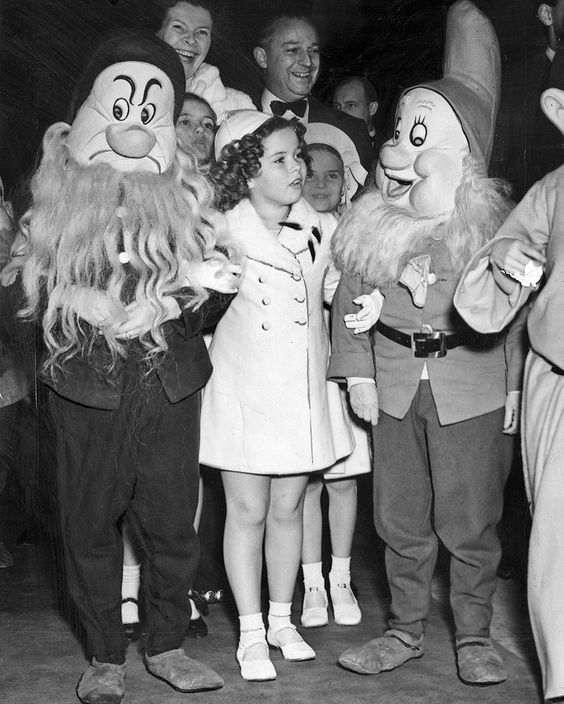 "Shirley Temple at the premiere of the animated feature ""Snow White and the Seven Dwarfs"" in 1937 at the Carthay Circle Theatre in Los Angeles. by theacademy"