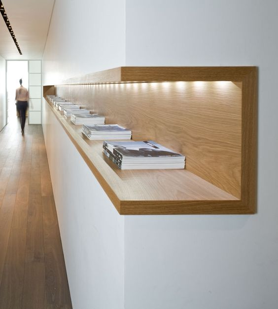 Interior architecture: wood shelf with in-built light. Neat and simple, love it!: