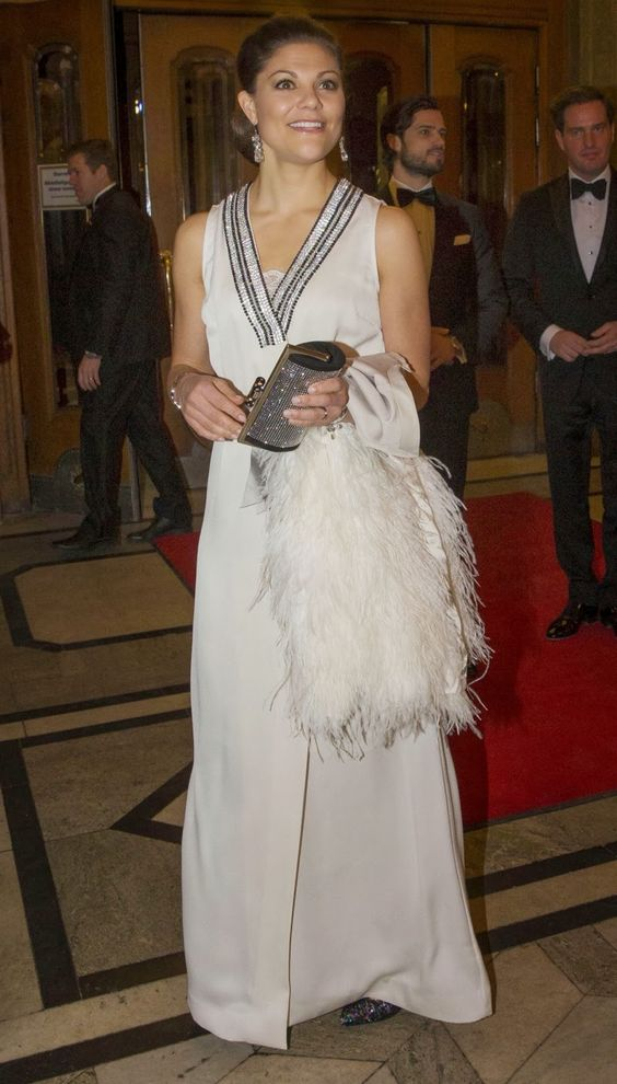 Swedish Crown Princess Victoria in By Malene Birger, coat, belt and shoes as she attends festivities at the Oscar Theatre in central Stockholm on 19.12.13