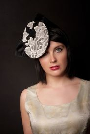 Striking black head piece, oval shaped with cream lace, finished off with a large black bow. This is a striking yet classic hat that will really get a room talking.This item may be purchased on ecofirstart.com