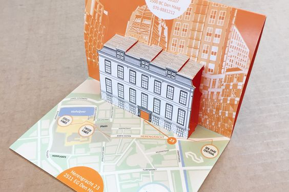 Pop-up moving card with illustrated map and house