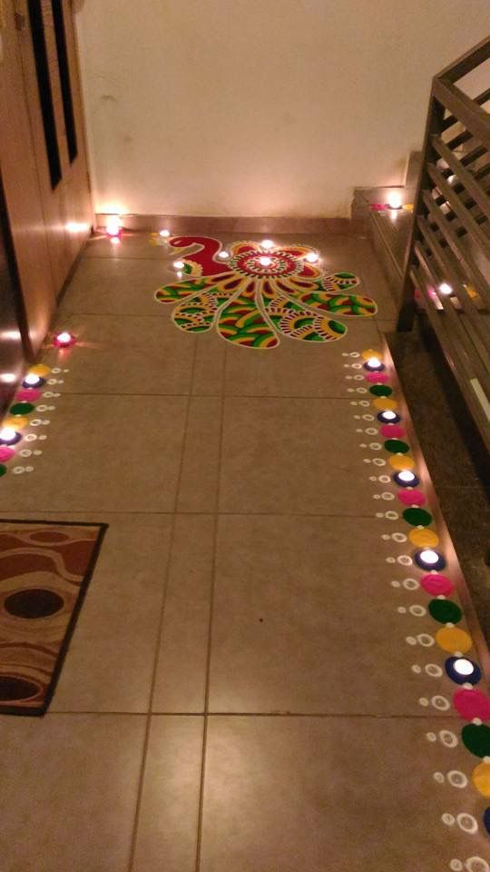 rangoli and diya