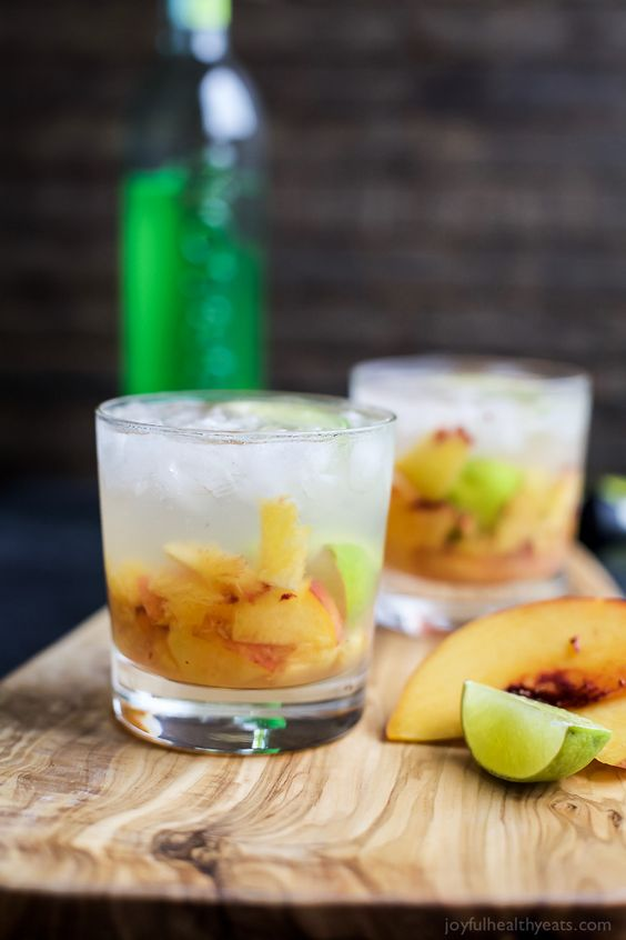 Brazilians know how to make a cocktail! Perfectly refreshing and easy to make - this Peach Caipirinha is hands my drink of choice!   joyfulhealthyeats.com