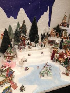 """My 2013 village- Department 56 North Pole. I made the pond with simple cardboard, paint and some """"realistic water"""" from the hobby store."""