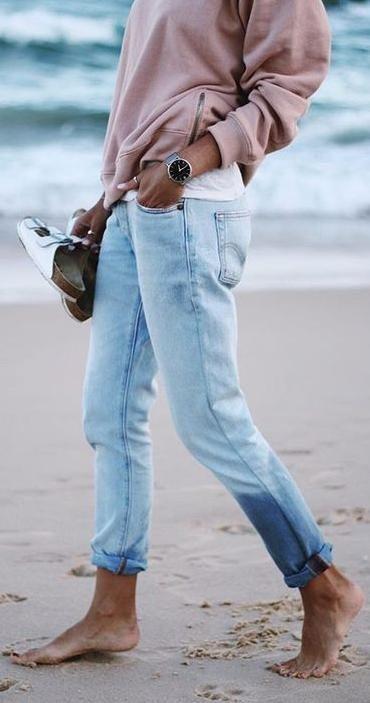 denim + sweatshirt. on the beach.