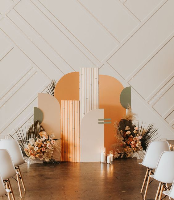 Colorful art deco inspired arched ceremony backdrop