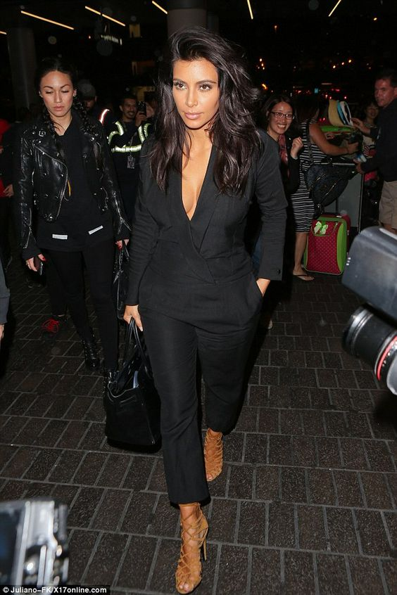 Serial skin flasher: Kim Kardashian showed off some cleavage as she flew out of Los Angele...