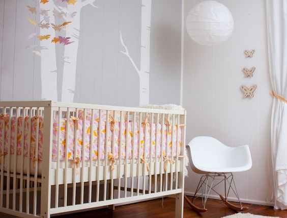 Modern gray nursery with girly accents