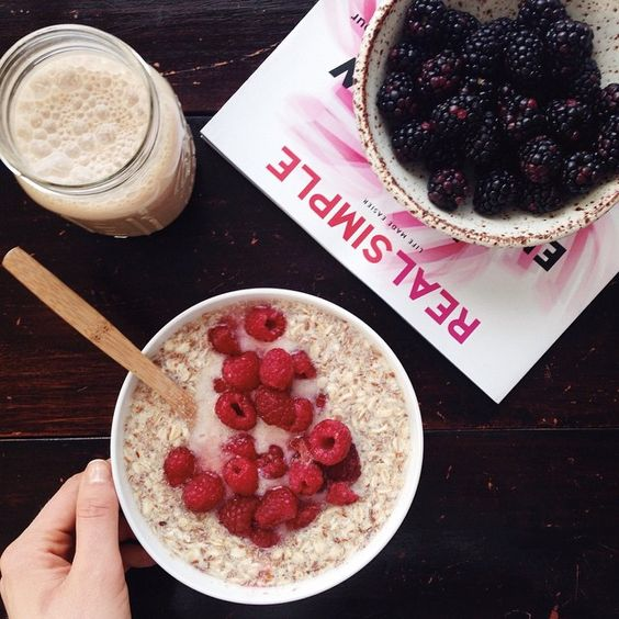 Just tested and finalized a morning porridge recipe for my cookbook, it's amazing, with a huge side of fresh blackberries in @sarahschembri_ceramics, @sproutliving epic vanilla lucuma protein shake, and the latest @realsimple issue. Wishing you all a beautiful morning! | with McKel of Nutrition Stripped