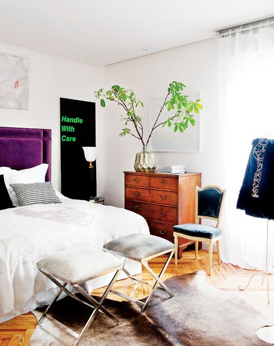 Tour a Fashion Designers Feminine Abode// velvet headboard, cow hide