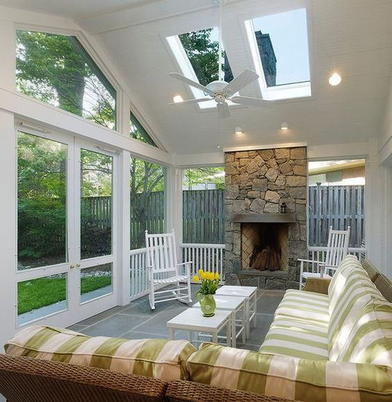 Sunroom with open fireplace! Love this idea. The room can then be used in summer and winter!