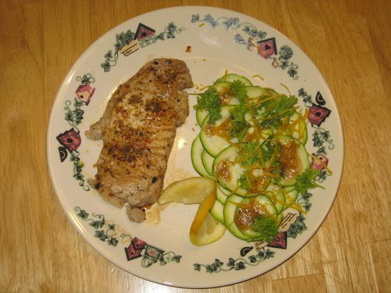 pork chops with zuccini salad How to make: Pork Chop Cook pork chop in frying pan add Veggie La Grill Spice, cook until white in the middle, top with soya sauce. Zuccini Salad thinly slice or shread Zuccini add lemon zest and parsly drizzle balsamic vinagarette dressing.