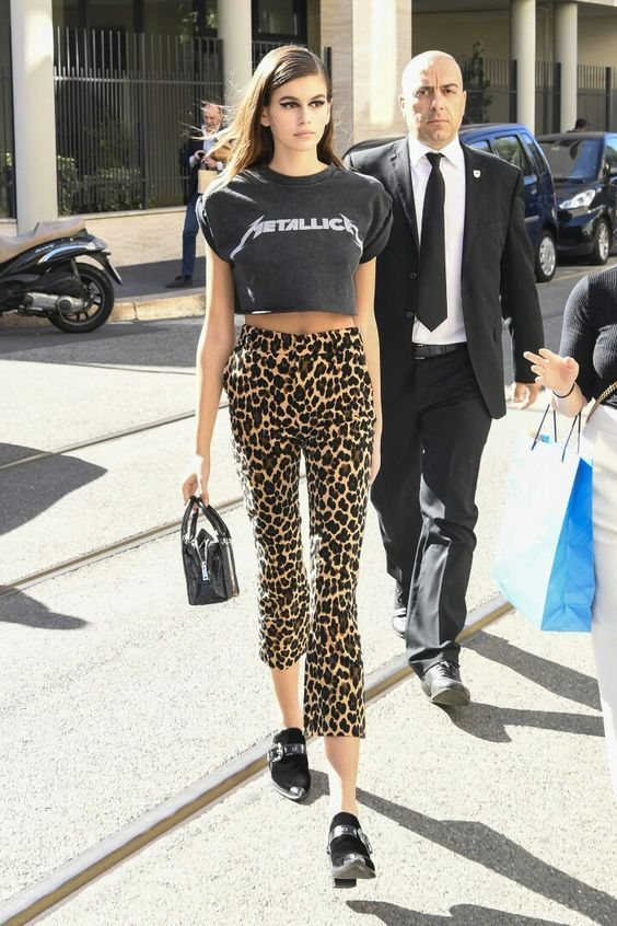 Kaia Gerber 2018. Outfit with animalier cropped flared pants.