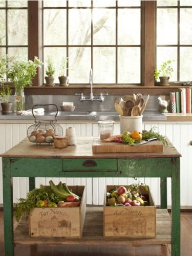 Love the old table, cutting board, crock with wooden spoons, wire basket with eggs. Gives it that farmhouse feel.: