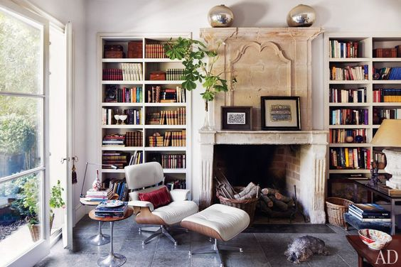 Isabel Lopez-Quesada's Elegant Madrid Villa :  Live the super old fireplace in this library.