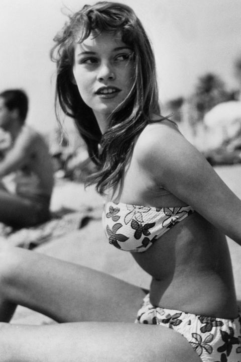 20 most iconic beach hair of all time: Brigitte Bardot keeps it sweet with a medium do and fun bangs.