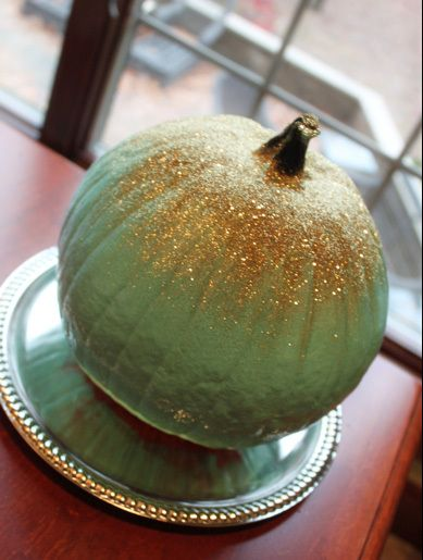 Mint & Gold Pumpkin   Materials needed: Pumpkin  Mint green paint Sassy Hippo Gold Prism Glitter Spray adhesive