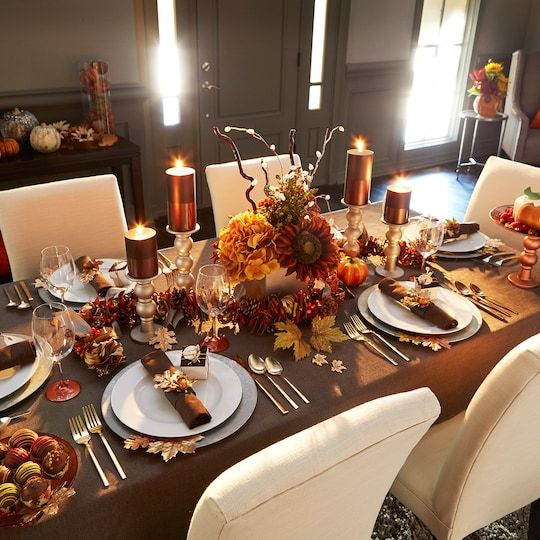 Fancy up your Thanksgiving tablescape with some metallic painted candlesticks and dipped candles.