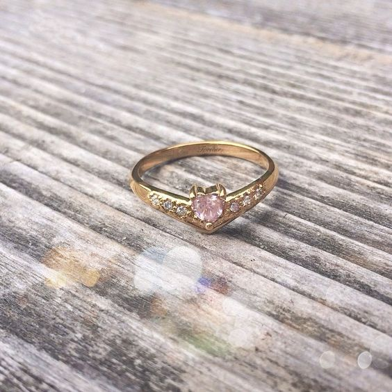 "Today we're all about #pink #tourmalines! Our ""V-Accented #Heart"" #Ring is the perfect way to show off that beautiful #gem, and #diamond accents on either side for that extra #sparkle!"