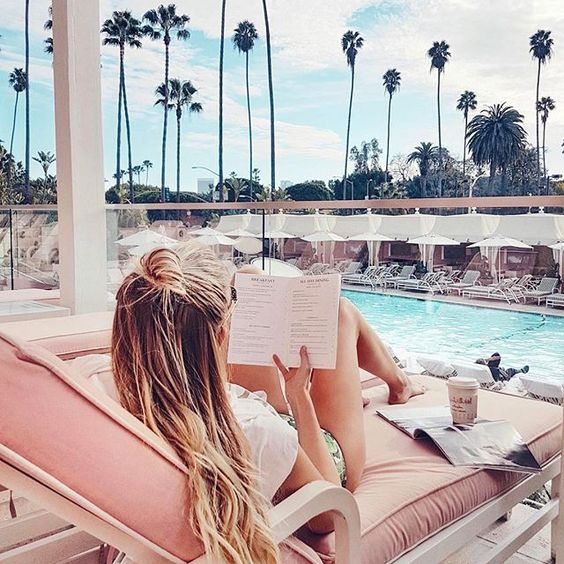 This might either be me reading Harry Potter or the pool bar menu. @bevhillshotel #DCMoments #BeverlyHillsHotel