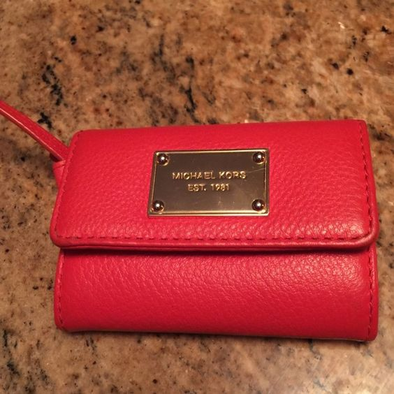 Michael Kors Fulton Wristlet Has zipper change purse.  No credit card holder bit will hold Bills,  or could put cards in zipper part.  I kept my keys on the strap.  Orange/ Red color and very Very lightly used.  No stains or tears MICHAEL Michael Kors Bags Wallets