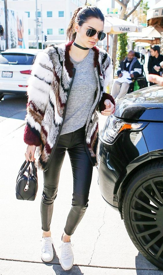 kendall jenner wears a gray t shirt patchwork fur coat leather pants