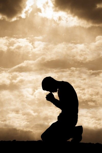 Kneeling In Prayer: