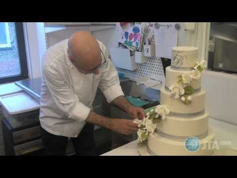 "Food Network ""Sweet Genius"" Ron Ben-Israel decorates a wedding cake"