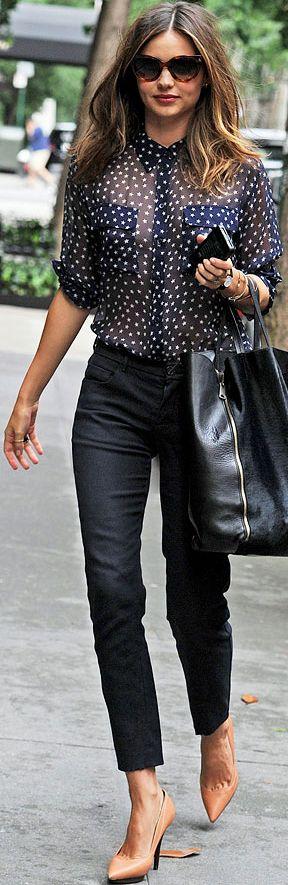 Looks like polka dot but its a star pattern, leather heels, navy blue pants. Miranda Kerr
