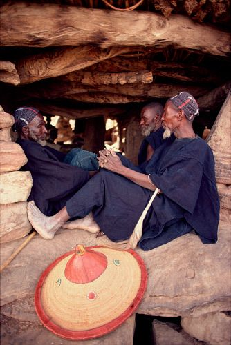 Africa | Dogon men sitting in the shade of the men's house, or Toguna. They wear indigo dyed clothing. Tirelli. Mali. | © Bryan & Cherry Alexander Photography / ArcticPhoto