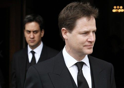 Ed Milliband (background) and Nick Clegg