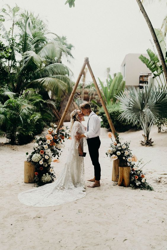 Modern Boho Beach Elopement in Tulum | Medina by Rue De Seine | Modern Wedding Inspiration | Elopement Inspiration | Modern wood triangle altar with modern florals | #aandbebridalshop #ruedeseine