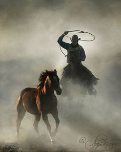 .Love this painting...cowboy, horse, dust flying...what an image!