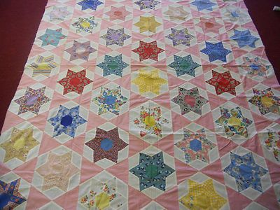 ALL HAND SEWN THIS SCRAPPY STAR QUILT TOP.  TOP WAS MADE IN THE LATE 1930'S TO EARLY 1040'S THERE ARE A FEW STAINS ON THIS TOP BUT ON HOLES OR TEARS