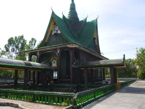 "A rather unusual temple in Thailand is the ""Wat Lan Khuat"" in Khun Han, Isaan. In English the temple is called the ""Million Bottle Temple"" or the ""Beer Bottle Temple."" This temple is not only interesting, it is a testament to the ingenuity and resourcefulness of the Thai monks that built it. #Temple #Thailand #Recycle For more information and a video: renegadetravels.com/beer-bottle-temple-in-thailand/ Photo credit: http://www.renegadetravels.com/"