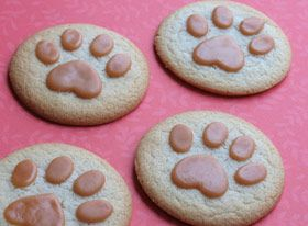 Lion Paw Print Cookies (sugar cookies, cookie sheet, waxed paper, 10x sugar, caramel candy cubes, rolling pin, small heart-shaped cookie cutter, small oval cookie cutter, wire cooling rack)