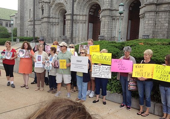 Catholics and sexual abuse survivors protest in front of the Cathedral Basilica…