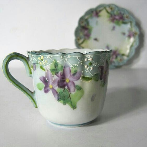 Vintage Hand painted porcelain cup and saucer